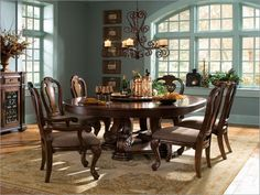 Dining Room: Unique Round Dining Room Furniture Sets With Antique Style Also With Wood Base Classic Chandelier Classic Carpet For Dining Room Antique Sideboard Buffet On The Dining Room from Be Intimate and Have a Friendly Dining with Round Dining Room Sets