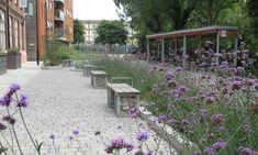 Six Ways Landscapes Can Be More Flood Resilient  // The new Derbyshire Street Pocket Park in Bethnal Green, London, incorporates sustainable urban drainage to better manage surface water run off, green-roof covered bike racks and bin stores, and bespoke planters that capture rainwater. Photograph: Greysmith Associates