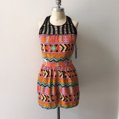 NWT Lovers + Friends tribal print romper Super cute silky polyester romper from Lovers + Friends.  Brand new with tags attached. Sleeveless, with a black open crotchet neckline yoke and back keyhole.  Fitted at the waist with a slim waistband.  Fully lined and opaque.  Fun aztec/tribal print in tones of orange, pink, and aqua. Size M, fits a 6 best. Lovers + Friends Dresses