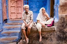 India, Jodhpur. Old couple at the door of a house.