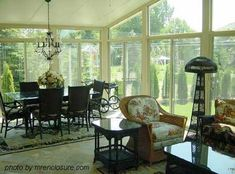 lighting for sun room | lighting fixture could be placed on a track to move from side of room toward center if table is pulled into room.
