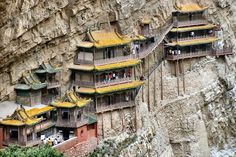 The Hanging Temple, located about 60 km southwest of Datong, China in Shanxi province, clings to a crag of Hengshan mountain. It consists of 40 rooms linked by a dizzying maze of passageways. The temple is said to have been built by a monk named Liao Ran, during the late Northern Wei Dynasty (386-534 AD) and restored in 1900.