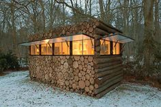 Wood pile hunting blind (or a really neat hidden cabin idea!)