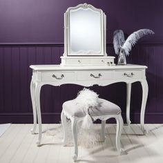 Oh, isn't this just simply divine! Our Chalk Dressing Table with mirror and stool from Frank Hudson is simply and elegantly designed. Handmade from mahogany by master craftsman this dressing table sits on oh so perfect cabriole legs and is highlighted by delicate shell and scroll work detailing. As you have come to expect from Frank Hudson is also finished by hand in a soft chalk white and is perfect for many an interior dream. This Dressing Table is finished off with signature handles th...