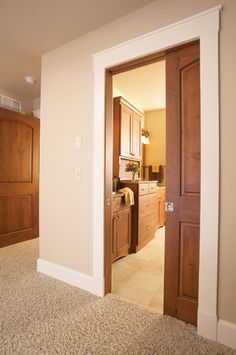 Great example of the look I like with the white flat trim and stained door.