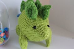 Here is a super cute stegosaurus toy!  He can be used as a childrens toy or as decoration for a nursery or bedroom  His green body is slightly
