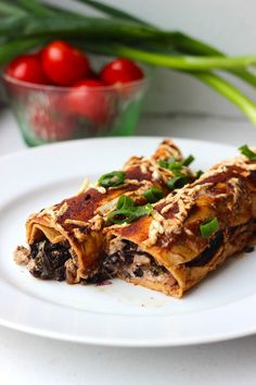 This vegan enchiladas recipe is full-flavored and features hearty kale, thickly-cut portobello mushrooms and a sprinkling of tofu.