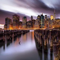Beautiful reflections and the Lower Manhattan skyline by night by Amanda G. @mcag_photo