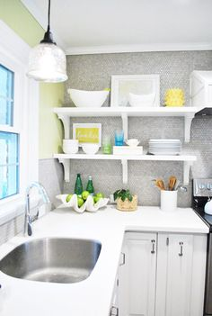 My favorite ever kitchen, from Young House Love.  Plain white corian countertops.