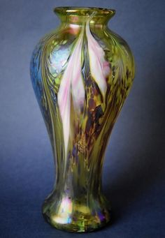 Richard Golding Station Glass Green Vase with Pink Flowers http://www.bwthornton.co.uk/isle-of-wight-richard-golding-bath-aqua-glass.php