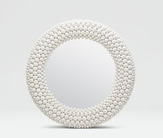 HELENE: A concentric pattern of artfully cast resin sea urchin shells give the Helene an earthy, graphic vibe. #madegoods #accent #mirror #statement #homedecor