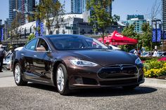 Tesla Model S in Brown. The best driving experience I've ever had! Fully touch-screen automated, zero to 60 in 5 seconds, and one of a kind.