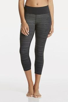Refresh your wardrobe with this versatile reflective-stripe crop, constructed with heat-control fabric to keep your body cool. | Ingrid Capri II - Fabletics