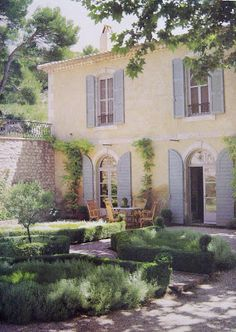 Front facade of French Country House with Provence Blue shutters.