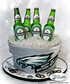 Heineken & Eagles themed beer bucket cake. All edible. LOTS of isomalt went into this one.