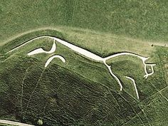The Uffington White Horse is a highly stylized prehistoric hill figure, 110 m long (374 feet), formed from deep trenches filled with crushed white chalk. Dates back to the Bronze Age. Oxfordshire,England