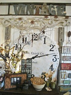 great antiques booth display - note letters from corrugated metal spells vintage. Antique Booth Displays, Antique Booth Ideas, Vintage Display, Vintage Decor, Vintage Clocks, Antique Decor, Flea Market Style, Flea Market Booth, Market Displays
