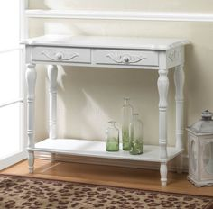 Carved White Hallway Table. Decorative carved white hallway accent table with two drawers. This traditional style, white accent table will compliment any decor in your home.