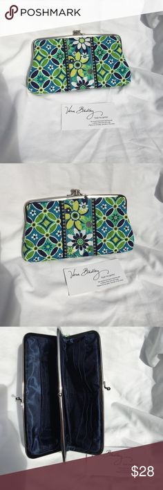 "Retired Vera Bradley Daisy Daisy Clutch Retired Vera Bradley Daisy Daisy Clutch- (1/08-5/09). excellent condition. Length across bottom 8"" length across top 7 1/2"". 4 1/2"" high. Green/lime, dark and bright blue, white and yellow. 6 slip pockets for cards and zip pocket on 1 side and a slip pocket w window for ID, small slip pocket and a large slip pocket on the other. Super cute! I Have matching barrel bag NWT separately listed for sale. Vera Bradley Bags Clutches & Wristlets"