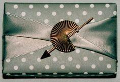 gift wrap - recycling project - tiny box, twistet satin ribbon & former earring  -  http://la-couronne.de/
