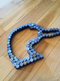 duck head created from used shotgun shells- great idea for decorating in a duck hunter's bedroom
