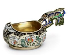 a_silver-gilt_and_cloisonne_enamel_kovsh_marked_k_faberge_with_the_imp_d5322040g.jpg (1024×833)