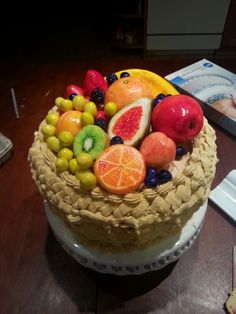 Xavier's 7th b'day cake. Made from Red velvet cake with vanilla icing. Fruit made from icing.