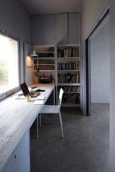 light and spacious work place, greyish painted wood