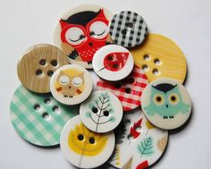 mod podge ugly or useless buttons with leftover scrapbook paper!