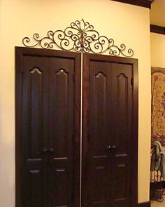1000 ideas about iron wall on pinterest wrought iron for Above door decoration