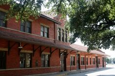 At this sleepy little Santa Fe Depot, I squinted my eyes and tried to imagine it as the bustling hub of Gainesville, Texas. That was hard to do when there wasn't another person on the street with m...