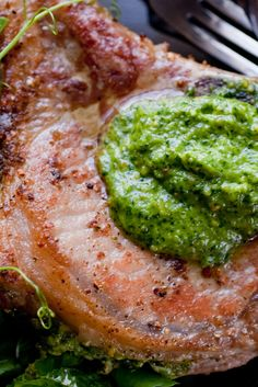 NYT Cooking: A pesto built on pea shoots, pine nuts and cilantro brightens this pork chop recipe. The chops are seared, then roasted in an oven for 15 minutes, putting dinner on the table in less than an hour. To serve, pair it with a light salad coated with lemon and olive oil, salt and pepper. Try it tonight.