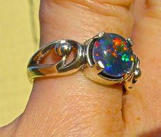 Graceful Fire Opal ring. Genuine Australian Natural Opal 8mm round Gemstone.Sterling Silver designer setting.Unique engagement wedding ring!