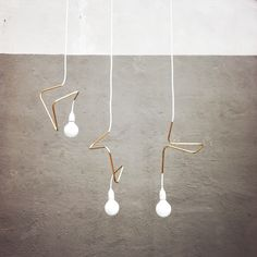 Helt Enkelt | lamp design by David Taylor  could diy as well...bent copper plumbing pipe + cord kit