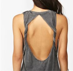 1. Take a shirt that is 1 - 2 sizes to big for you 2.Cut the arms off, Make sure you cut off some of the sides so it hangs loose. 3.Cut from the arm to the neck hole right on the shoulder seam. 4. Cut a teardrop shape out the back of the shirt, leaving the neckline in tact. 5. Take the hole on the back of the shirt and twist the top part inward through the hole a couple times. 6. Sew the shoulder seam together again and enjoy this beautiful, fun muscle shirt :)