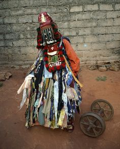 Africa | Voodoo in Bénin, Egungun secret society | These ancestral spirits are believed to be in constant watch of their survivors on Earth. They bless, protect, warn, and punish their Earth relatives, depending on how their relatives neglect or remember them. They protect the community against evil spirits, epidemics, witch-craft, and evil doers, ensuring their well-being. The ancestral spirits may be invited to the Earth physically, Egungun are the receptacles of these spririts.