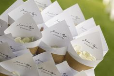 what an adorable wedding idea- flower petals to throw for the guests!