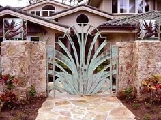 Design is similar to Bird Of Paradise leaves. Note the bird of paradise detail on each light fixture on the sides. Driveway Gates For Sale, Aluminum Driveway Gates, Metal Fence Gates, Chain Link Fence Gate, Wrought Iron Driveway Gates, Home Gate Design, House Design, Tor Design, Gate Way