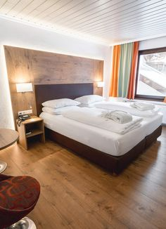 Alpen Adria Hotel & Spa am Pressegger See Spa Hotel, Furniture, Home Decor, Ski Trips, Hotel Bedrooms, Family Vacations, Interior Designing, Bed, Decoration Home