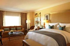 Each comfortable room at the Waldorf Astoria Orlando includes in-room movies, a spa bath and a private bathroom. Amenities featured in the r...