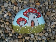 Toadstools : painted pebble...pretty mushroom houses!!