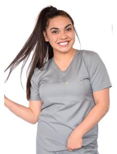 not your charcoal whitening, DHN's charcoal scrub! relaxed, yet semi-fitted to conform and adapt to your daily activities. rounded, scoop hem to silhouette a woman's figure. includes left chest pocket, decorated with DHN's gold tooth. material is water-wicking and stain resistant.