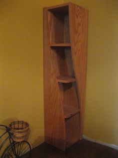 """Corner Shelf with a Twist  Cool,Corner shelf...Designed to appear twisted when viewed from a certain angle. Dim. 4ft x 10"""" x 10"""". The last darker """"red oak"""" picture is for reference only, it is constructed of oak ply only. I am now building these with solid oak boards and oak plywood back, it is a much nicer piece. I just added pictures of one built with solid boards, it features a hand-rubbed natural oil finish  $325"""