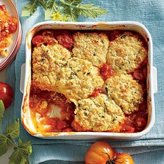 Savory Tomato Cobbler | Stone-ground cornmeal adds texture to the biscuit-like crust, but you can use plain cornmeal or your favorite biscuit recipe. | #Recipes | SouthernLiving.com