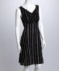 This sophisticated spin on a little black dress boasts a feminine silhouette and back-zip design. Intricate pinstripes take the menswear print and make it fresh and feminine, while the classic A-line cut flatters any figure.