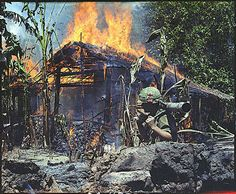 My Tho, Vietnam. A Viet Cong base camp being destroyed. In the foreground is Private First Class Raymond Rumpa, St Paul, Minnesota, C Company, 3rd Battalion, 47th Infantry, 9th Infantry Division, with 45 pound 90mm recoiless rifle. (April 5, 1968)  (Picture courtesy of the National Archives and Records Administration.)