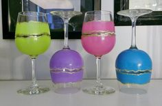 These are fun hand painted wine glasses. Great for parties, everyone can have their own color.