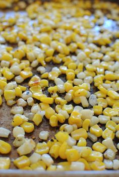 Spread frozen corn on baking sheet, sprinkle with olive oil and salt & pepper. Broil for 5 minutes. This is my new favorite way to cook corn! I love that you can use frozen corn, and it was SO easy!