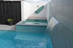 small swimming pool and water fall feature, by Mayfair Pools