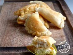 The South African Poli is a crescent shaped pastry filled with a sweet cardamom and desiccated coconut center- similar to the Indian treat G...